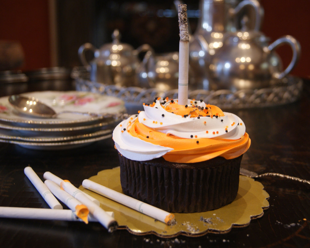 cupcake with a cigarette for a candle